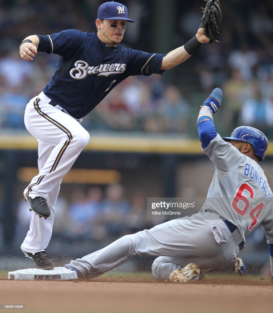 <a gi-track='captionPersonalityLinkClicked' href=/galleries/search?phrase=Emilio+Bonifacio&family=editorial&specificpeople=4193706 ng-click='$event.stopPropagation()'>Emilio Bonifacio</a> #64 of the Chicago Cubs beats the throw to <a gi-track='captionPersonalityLinkClicked' href=/galleries/search?phrase=Scooter+Gennett&family=editorial&specificpeople=5502894 ng-click='$event.stopPropagation()'>Scooter Gennett</a> #2 of the Milwaukee Brewers during the top of the fourth inning against the Milwaukee Brewers at Miller Park on May 31, 2014 in Milwaukee, Wisconsin.