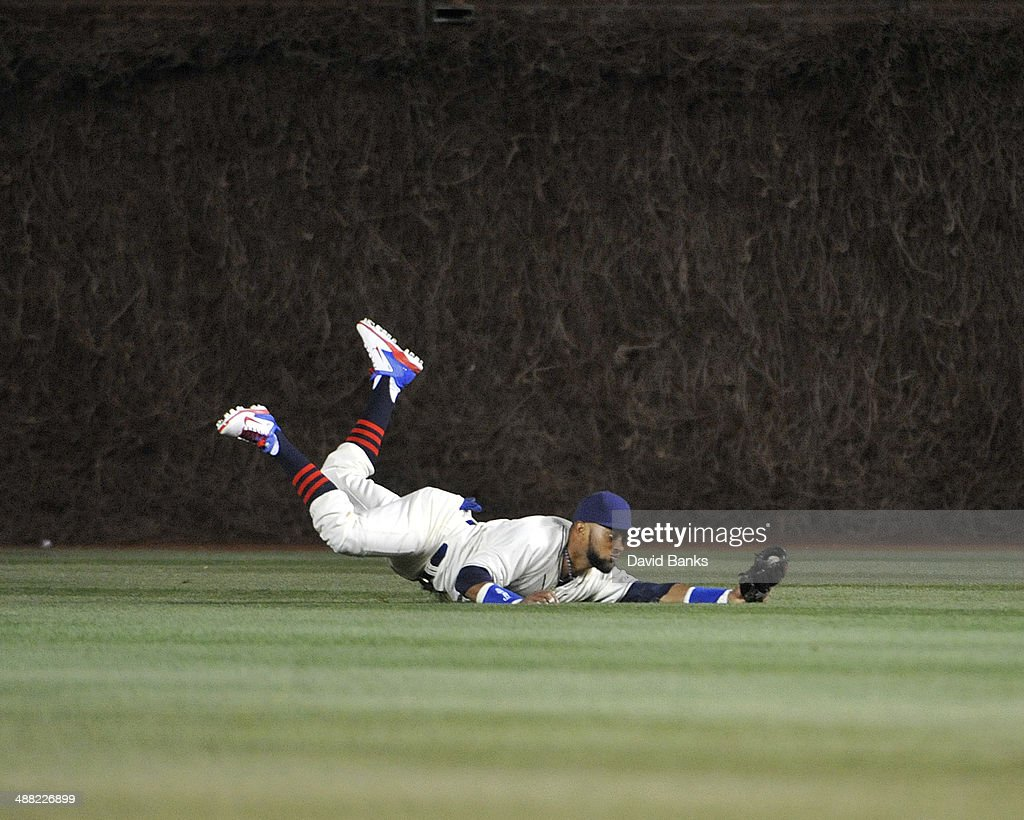<a gi-track='captionPersonalityLinkClicked' href=/galleries/search?phrase=Emilio+Bonifacio&family=editorial&specificpeople=4193706 ng-click='$event.stopPropagation()'>Emilio Bonifacio</a> #64 of the Chicago Cubs makes a catch on Mark Ellis (not pictured) of the St. Louis Cardinals during the seventh inning on May 4, 2014 at Wrigley Field in Chicago, Illinois.