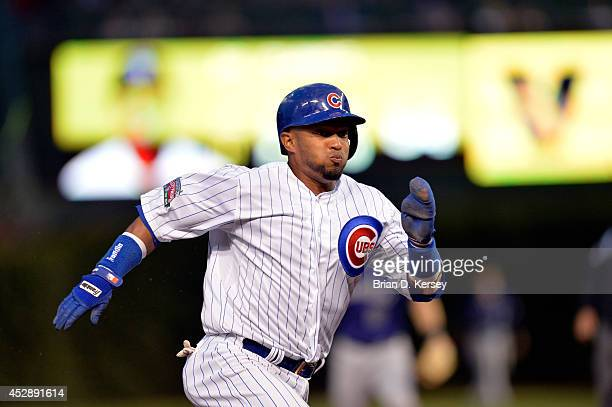 Emilio Bonifacio of the Chicago Cubs runs towards third base during the fourth inning against the Colorado Rockies on July 28 2014 at Wrigley Field...