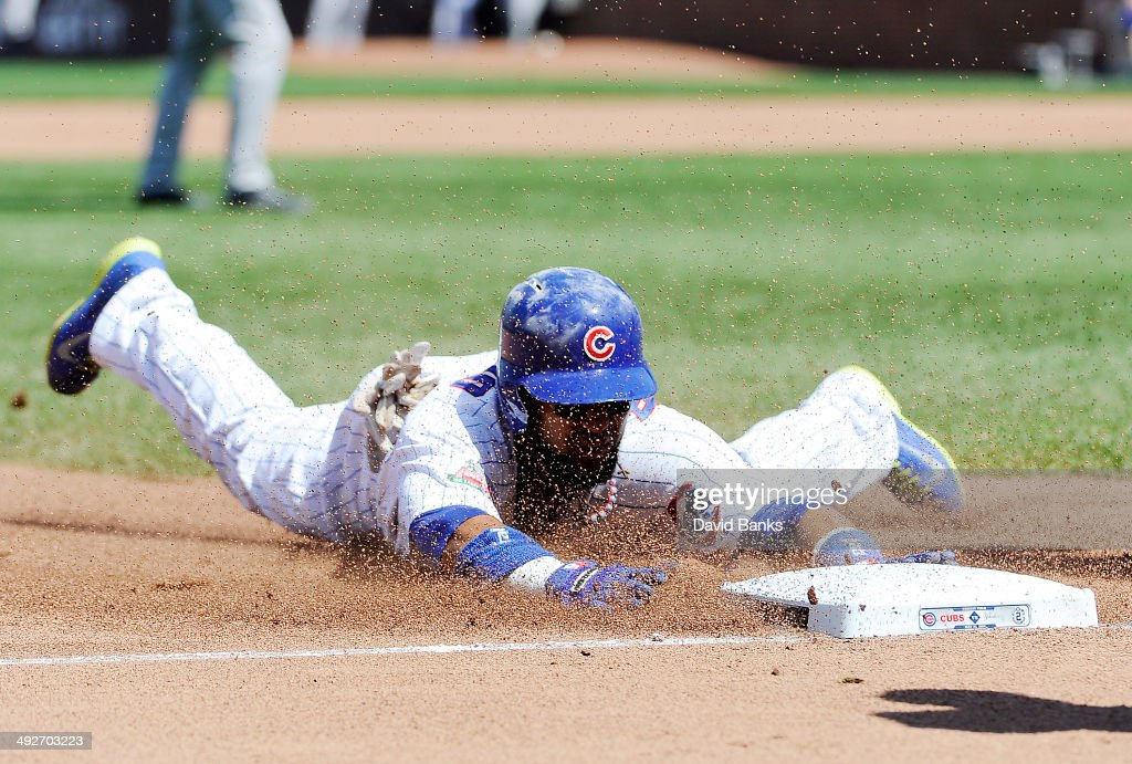 <a gi-track='captionPersonalityLinkClicked' href=/galleries/search?phrase=Emilio+Bonifacio&family=editorial&specificpeople=4193706 ng-click='$event.stopPropagation()'>Emilio Bonifacio</a> #64 of the Chicago Cubs slides safely into third base with a triple against the New York Yankees during the fifth inning on May 21, 2014 at Wrigley Field in Chicago, Illinois.