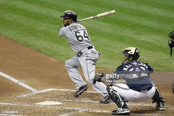 Emilio Bonifacio of the Chicago White Sox makes some contact at the plate during the interleague game against the Milwaukee Brewers at Miller Park on...