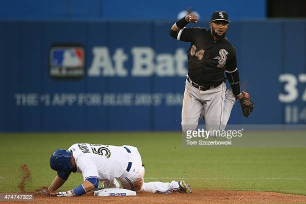 Emilio Bonifacio of the Chicago White Sox turns a double play in the sixth inning during MLB game action as Russell Martin of the Toronto Blue Jays...