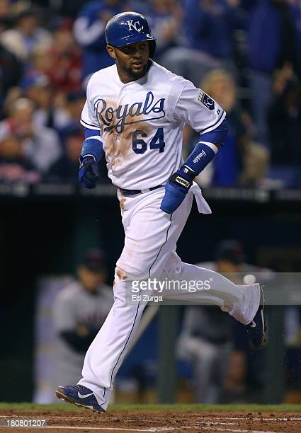 Emilio Bonifacio of the Kansas City Royals crosses home to score on a Billy Butler single in the first inning against the Cleveland Indians on...