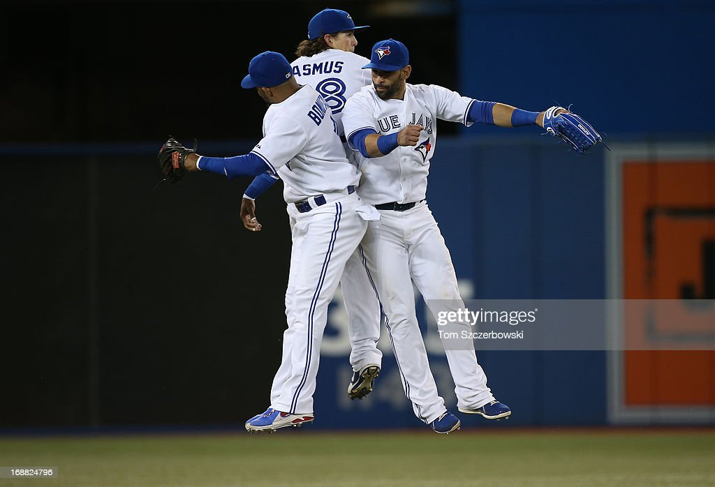 <a gi-track='captionPersonalityLinkClicked' href=/galleries/search?phrase=Emilio+Bonifacio&family=editorial&specificpeople=4193706 ng-click='$event.stopPropagation()'>Emilio Bonifacio</a> #1 of the Toronto Blue Jays and <a gi-track='captionPersonalityLinkClicked' href=/galleries/search?phrase=Colby+Rasmus&family=editorial&specificpeople=3988372 ng-click='$event.stopPropagation()'>Colby Rasmus</a> #28 and Jose Bautista #19 celebrate their victory during MLB game action against the San Francisco Giants on May 15, 2013 at Rogers Centre in Toronto, Ontario, Canada.