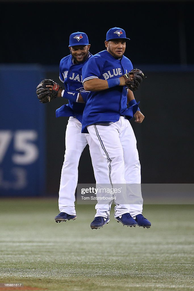 Emilio Bonifacio #1 of the Toronto Blue Jays celebrates with Melky Cabrera #53 during MLB game action after defeating the Boston Red Sox on April 6, 2013 at Rogers Centre in Toronto, Ontario, Canada.