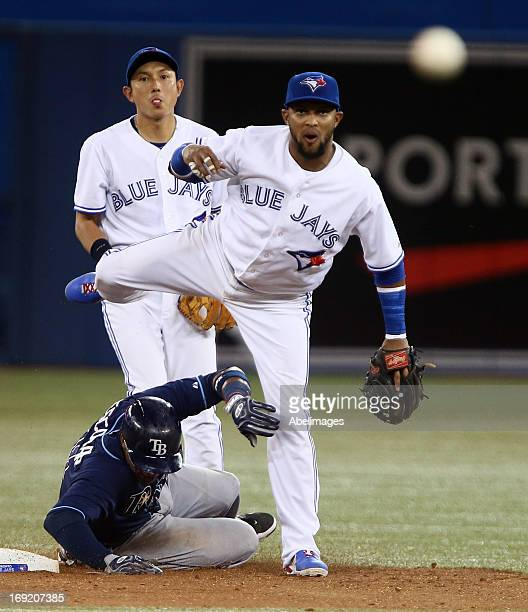 Emilio Bonifacio of the Toronto Blue Jays makes the play at second on Yunel Escobar of the Tampa Bay Rays as Munenori Kawasaki looks on during MLB...