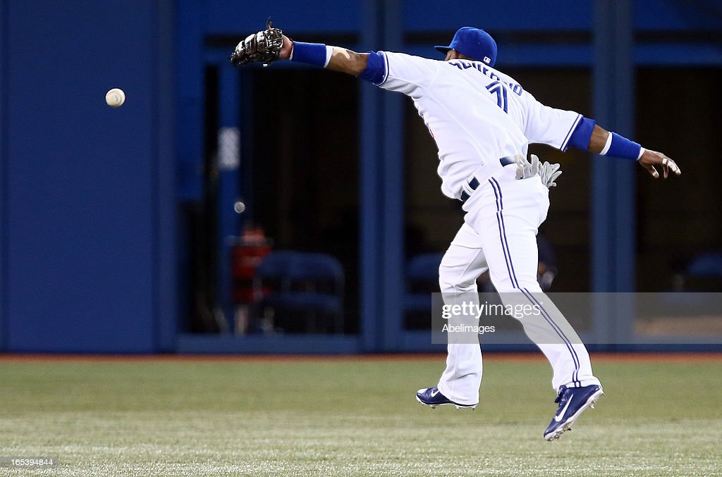 Emilio Bonifacio #1 of the Toronto Blue Jays misses a line drive in the second inning against the Cleveland Indians during MLB action at the Rogers Centre April 3, 2013 in Toronto, Ontario, Canada.