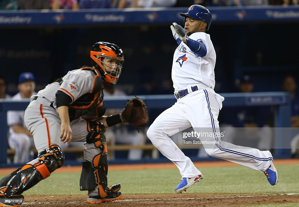 <a gi-track='captionPersonalityLinkClicked' href=/galleries/search?phrase=Emilio+Bonifacio&family=editorial&specificpeople=4193706 ng-click='$event.stopPropagation()'>Emilio Bonifacio</a> #1 of the Toronto Blue Jays slides to score a run in the seventh inning during MLB game action as <a gi-track='captionPersonalityLinkClicked' href=/galleries/search?phrase=Buster+Posey&family=editorial&specificpeople=4896435 ng-click='$event.stopPropagation()'>Buster Posey</a> #28 of the San Francisco Giants waits for the throw on May 14, 2013 at Rogers Centre in Toronto, Ontario, Canada.