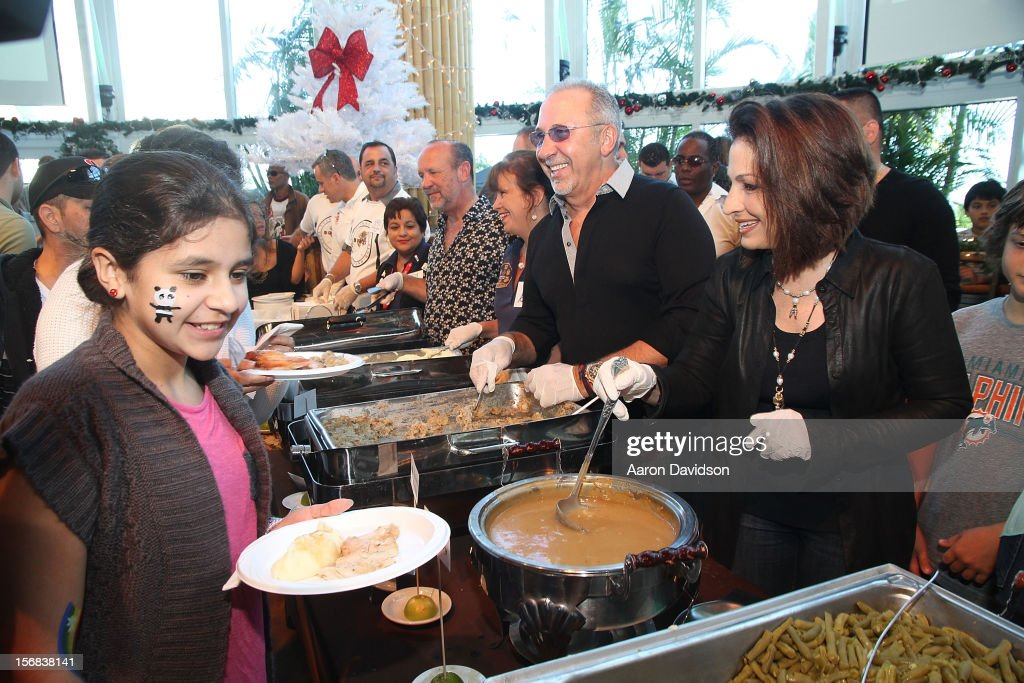 Emilio Estefan and Gloria Estefan participate in 5th Annual Thanksgiving Feed A Friend at Bongos on November 22, 2012 in Miami, Florida.