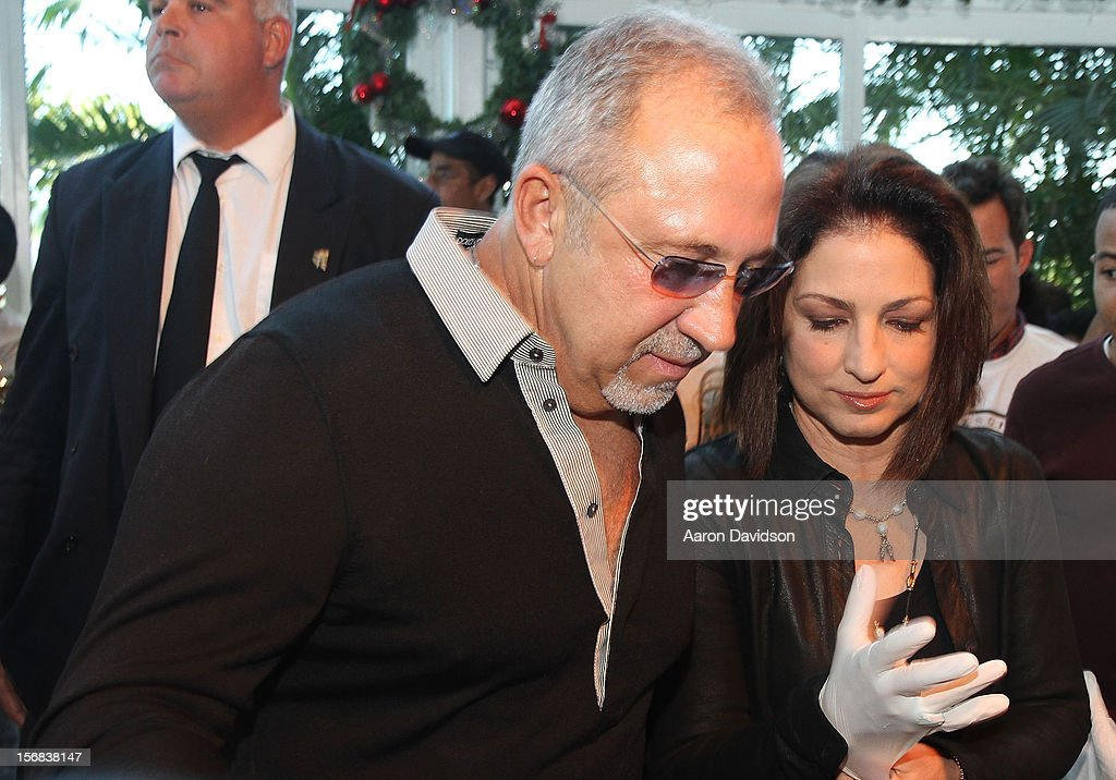 <a gi-track='captionPersonalityLinkClicked' href=/galleries/search?phrase=Emilio+Estefan&family=editorial&specificpeople=210517 ng-click='$event.stopPropagation()'>Emilio Estefan</a> and <a gi-track='captionPersonalityLinkClicked' href=/galleries/search?phrase=Gloria+Estefan&family=editorial&specificpeople=201703 ng-click='$event.stopPropagation()'>Gloria Estefan</a> participate in 5th Annual Thanksgiving Feed A Friend at Bongos on November 22, 2012 in Miami, Florida.