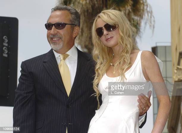 Emilio Estefan and Lindsay Lohan during Emilio Estefan Honored With a Star on the Hollywood Walk of Fame for His Achievements in Music at Hollywood...