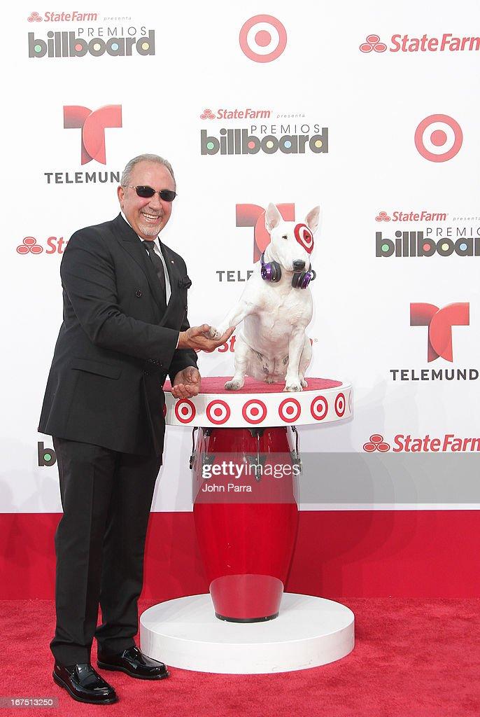 Emilio Estefan celebrates with Bullseye, Target's Beloved Bull Terrier Mascot, at the 2013 Billboard Latin Music Awards at BankUnited Center on April 25, 2013 in Miami, Florida.