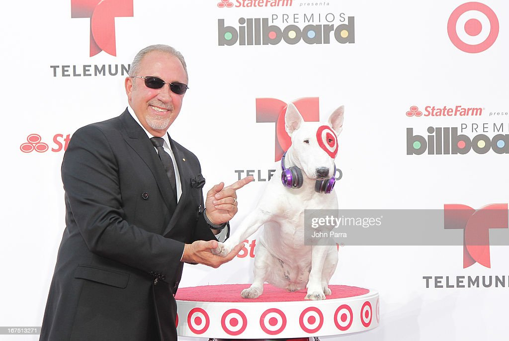 <a gi-track='captionPersonalityLinkClicked' href=/galleries/search?phrase=Emilio+Estefan&family=editorial&specificpeople=210517 ng-click='$event.stopPropagation()'>Emilio Estefan</a> celebrates with Bullseye, Target's Beloved Bull Terrier Mascot, at the 2013 Billboard Latin Music Awards at BankUnited Center on April 25, 2013 in Miami, Florida.