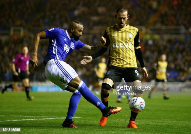 Emilio Nsue of Birmingham City attempts to clear the ball under pressure from Steven Fletcher of Sheffield Wednesday during the Sky Bet Championship...