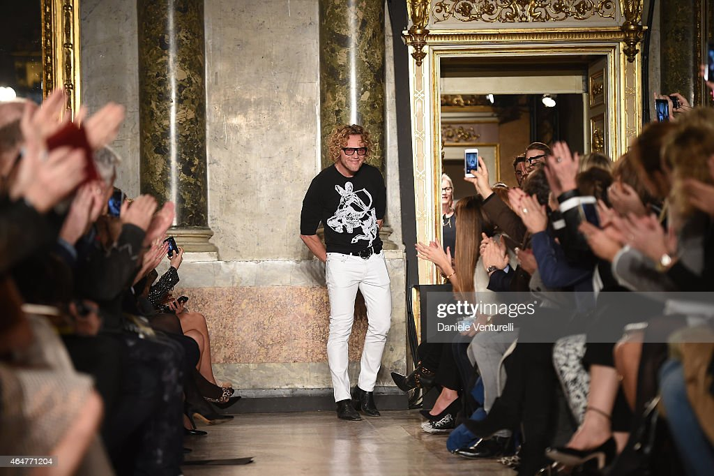 Emilio Pucci designer Peter Dundas acknowledges the applause of the public after the Emilio Pucci show during the Milan Fashion Week Fall/Winter 2015...