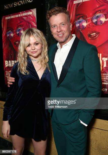 Emily Alyn Lind and McG attend the Los Angeles Premiere of 'The Babysitter' on October 11 2017 in Los Angeles California