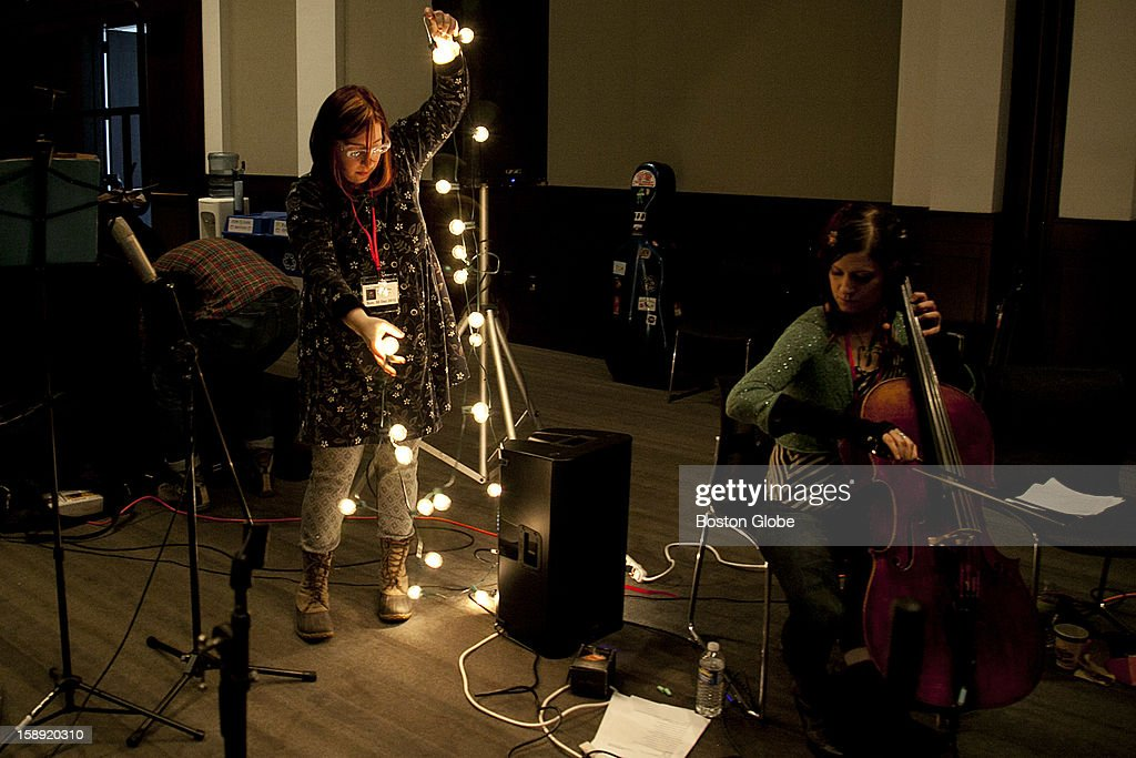 Emily Arkin, left, a violinist and guitar player, and Rachel Barringer, a cello player, set up before practice with Animal Hospital before performing at First Night, Boston's New Year's Eve celebration, on Sunday, Dec. 30, 2012.