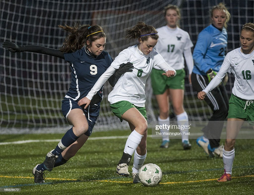 Emily Beatty of Loudoun County tries to steal the ball away from Woodgrove's #6 Madalyn Grafton in the first half at Woodgrove Tuesday April 2, 2013 in Purcelville, VA. Loudoun County won 1-0 on a goal by Emily Beatty.