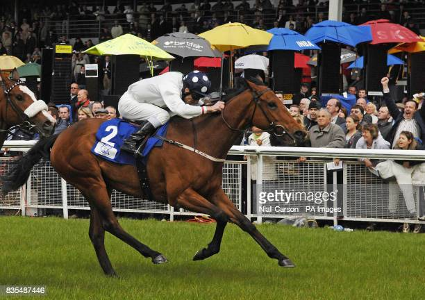 Emily Blake ridden by Johnny Murtagh crosses the line on to win the Tri Equestrian Stakes during the Boylesportscom Irish 2000 Guineas Day at Curragh...