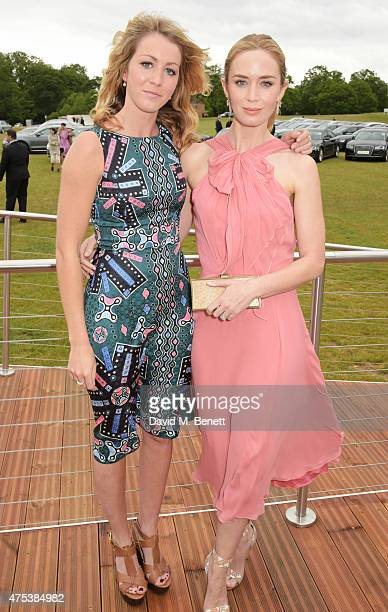 Emily Blunt and sister Suzanna Blunt attend day two of the Audi Polo Challenge at Coworth Park on May 31 2015 in London England