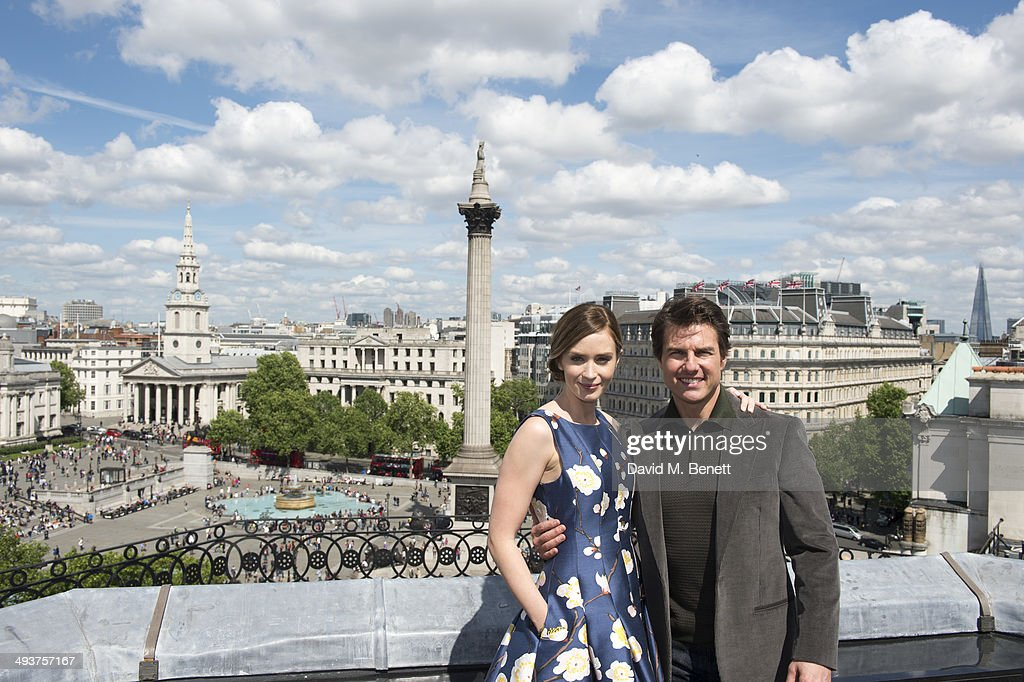Emily Blunt and Tom Cruise pose at a photocall for 'Edge Of Tomorrow' on the rooftop of the Trafalgar Hotel on May 25, 2014 in London, England.