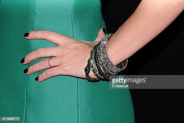 Emily Blunt ring/bracelet detail attends 'The Girl on the Train' New York premiere at Regal EWalk Stadium 13 on October 4 2016 in New York City