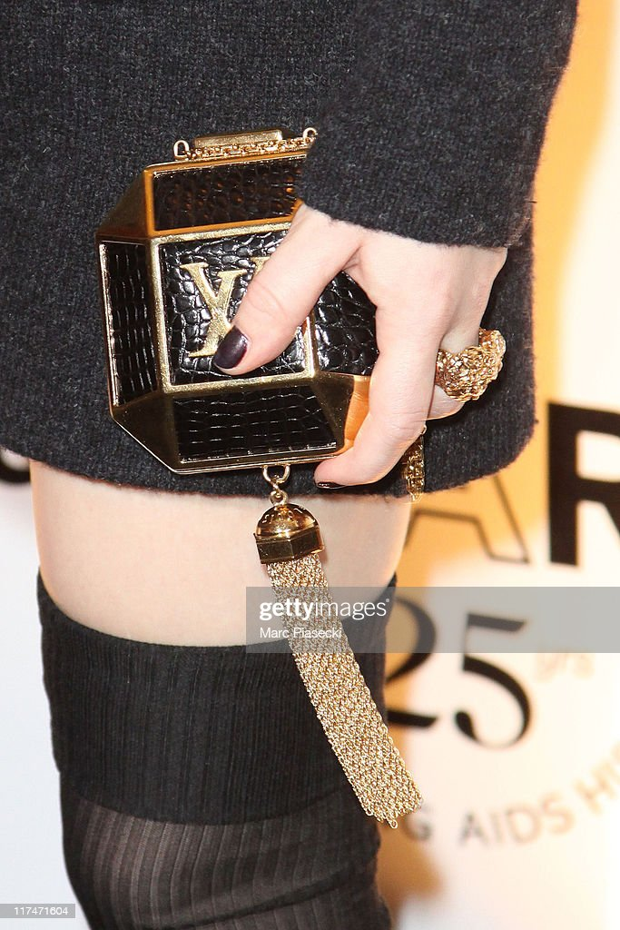 Emily Browning (handbag detail) attends the amfAR Inspiration Gala photocall at Pavillon Gabriel on June 23, 2011 in Paris, France.
