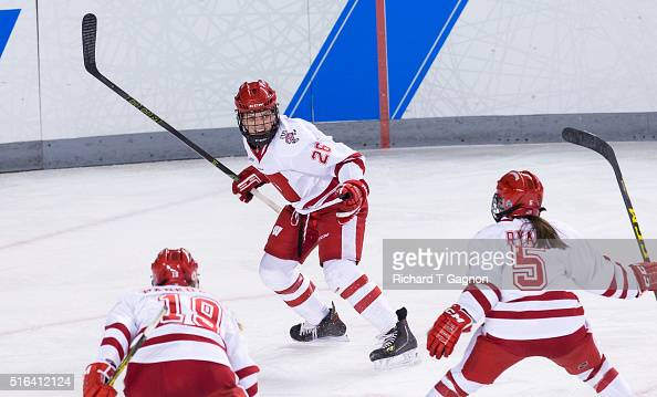 Emily Clark of the Wisconsin Badgers celebrates her goal against the Minnesota Golden Gophers with teammates Jenny Ryan and Annie Pankowski during...