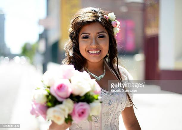 Emily Desiree Mendez celebrates her quinceanera before taking part in the third annual Grand Marian Europeanstyle procession from La Placita to the...