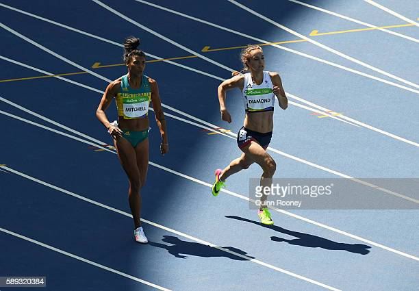 Emily Diamond of Great Britain and Morgan Mitchell of Australia competes in round one of the Women's 400m on Day 8 of the Rio 2016 Olympic Games at...