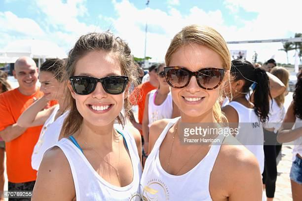 Emily DiDonato and Hannah Ferguson attend Sports Illustrated Swimsuit Beach Volleyball Tournament on Ocean Drive at Miami Beach on February 20 2014...