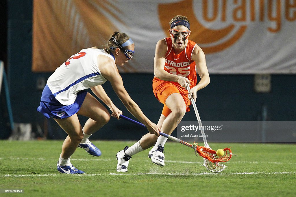 Emily Dohony #2 of the Florida Gators and Michelle Tumolo #35 of the Syracuse Orange battle for control of the ball during the 2013 Orange Bowl Lacrosse Classic on March 2, 2013 at SunLife Stadium in Miami Gardens, Florida.