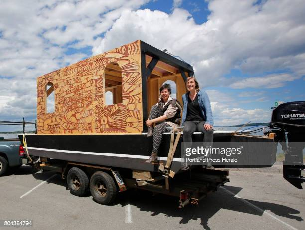 Emily du Houx and Moran Rogers right of Carrier Pigeon Studio sit upon the shanty boat/showboat Michi Zeebee a floating sculpture and boat that will...