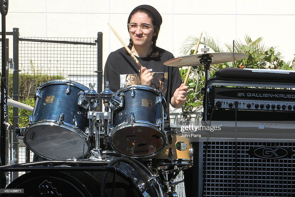 Emily Estefan performs in Gloria & Emilio Estefan Host 6th Annual Thanksgiving Day 'Feed A Friend' Event at Bongos Cuban Cafe at Bongos on November 28, 2013 in Miami, Florida.