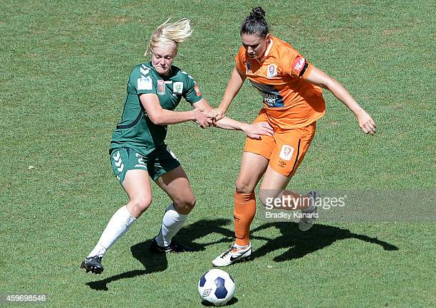 Emily Gielnik of Brisbane and Catherine Brown of Canberra challenge for the ball during the round 11 WLeague match between Brisbane Roar and Canberra...