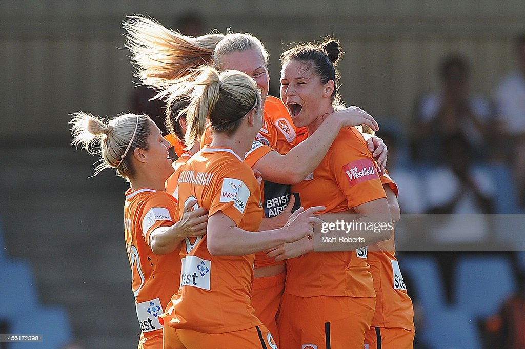 Emily Gielnik of the Roar celebrates scoring a goal with team mates during the round three WLeague match between the Brisbane Roar and the Newcastle...