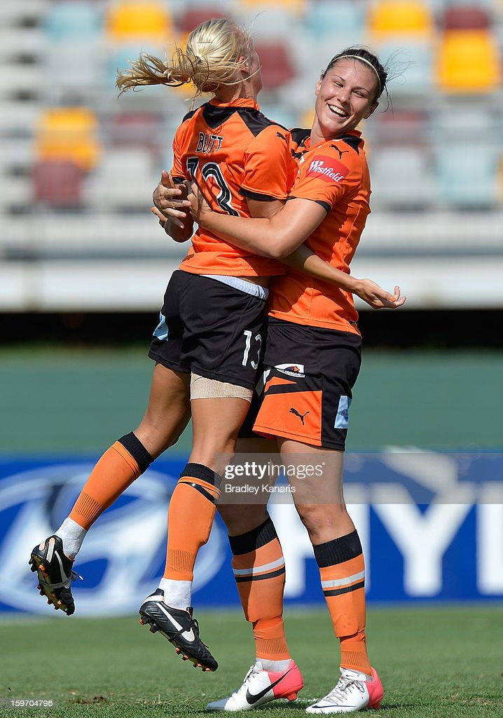 Emily Gielnik (R) of the Roar celebrates with team mate Tameka Butt after scoring a goal during the W-League Semi Final match between the Brisbane Roar and Sydney FC at Queensland Sport and Athletics Centre on January 19, 2013 in Brisbane, Australia.