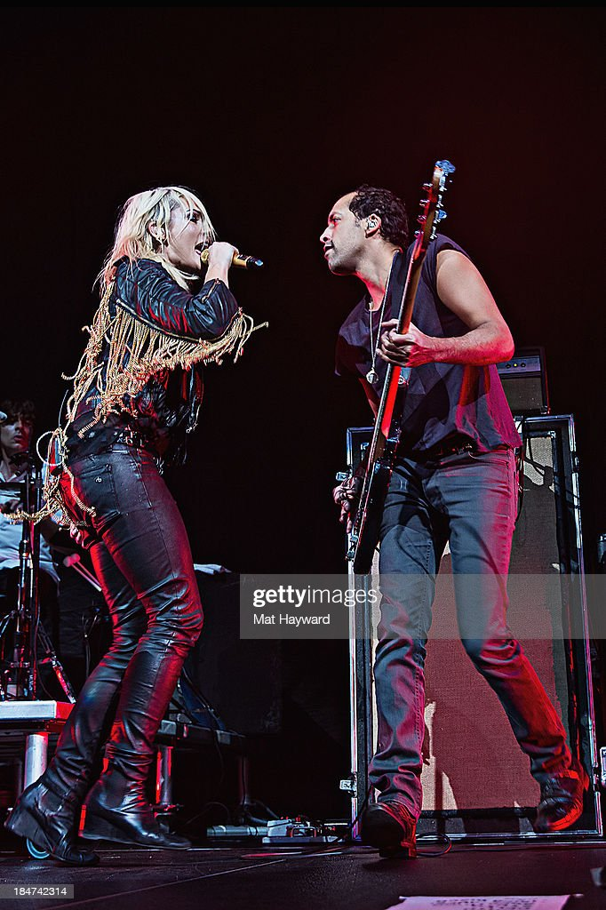 <a gi-track='captionPersonalityLinkClicked' href=/galleries/search?phrase=Emily+Haines&family=editorial&specificpeople=557275 ng-click='$event.stopPropagation()'>Emily Haines</a> (L) and Joshua Winstead of Metric perform on stage at Key Arena on October 15, 2013 in Seattle, Washington.