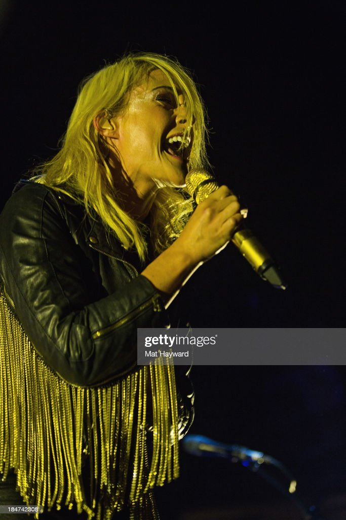 <a gi-track='captionPersonalityLinkClicked' href=/galleries/search?phrase=Emily+Haines&family=editorial&specificpeople=557275 ng-click='$event.stopPropagation()'>Emily Haines</a> of Metric performs on stage at Key Arena on October 15, 2013 in Seattle, Washington.