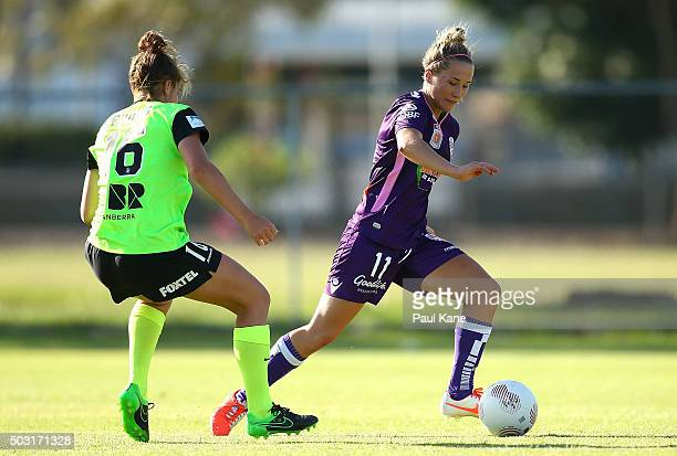 Emily Henderson of the Glory controls the ball against Tegan Riding of Canberra during the round 12 WLeague match between Perth Glory and Canberra...