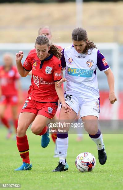 Emily Hodgson of Adelaide United competes with Perth Glorys Danielle Brogan during the round three WLeague match between Adelaide United and the...