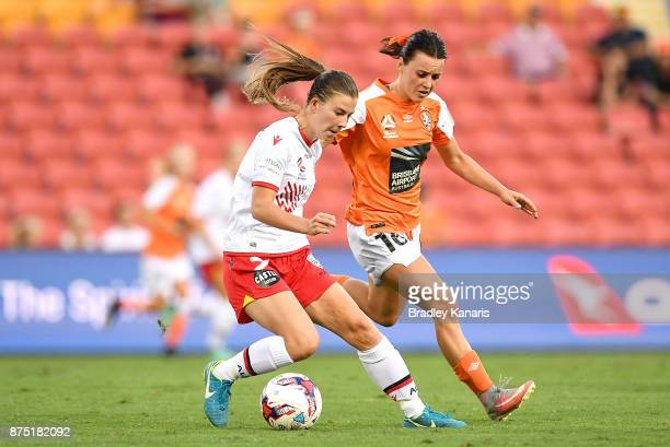 Emily Hodgson of Adelaide United is challenged by Hayley Raso of the Roar during the round four WLeague match between Brisbane and Adelaide at...