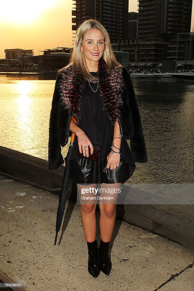 Emily Hogan wears a shirt by Cameo The Label, vintage necklace, jacket by Toi et Moi, shorts by Stylestalker and boots by 3.1 Phillip Lim on day four at L'Oreal Melbourne Fashion Festival on March 21, 2013 in Melbourne, Australia.