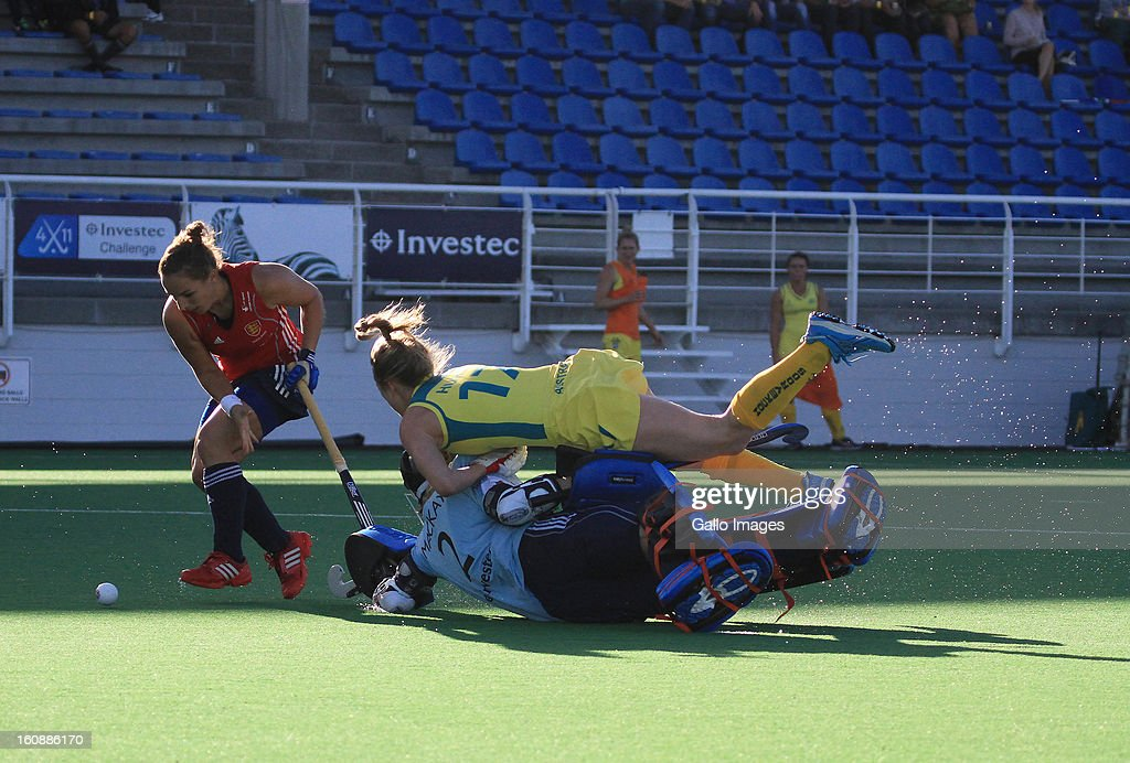 Emily Hurtz of Australia collides into Kirsty Hinch of England during the Investec Women's International Hockey Challenge match between England and Australia from Hartleyvale Hockey Stadium on February 07, 2013 in Cape Town, South Africa.