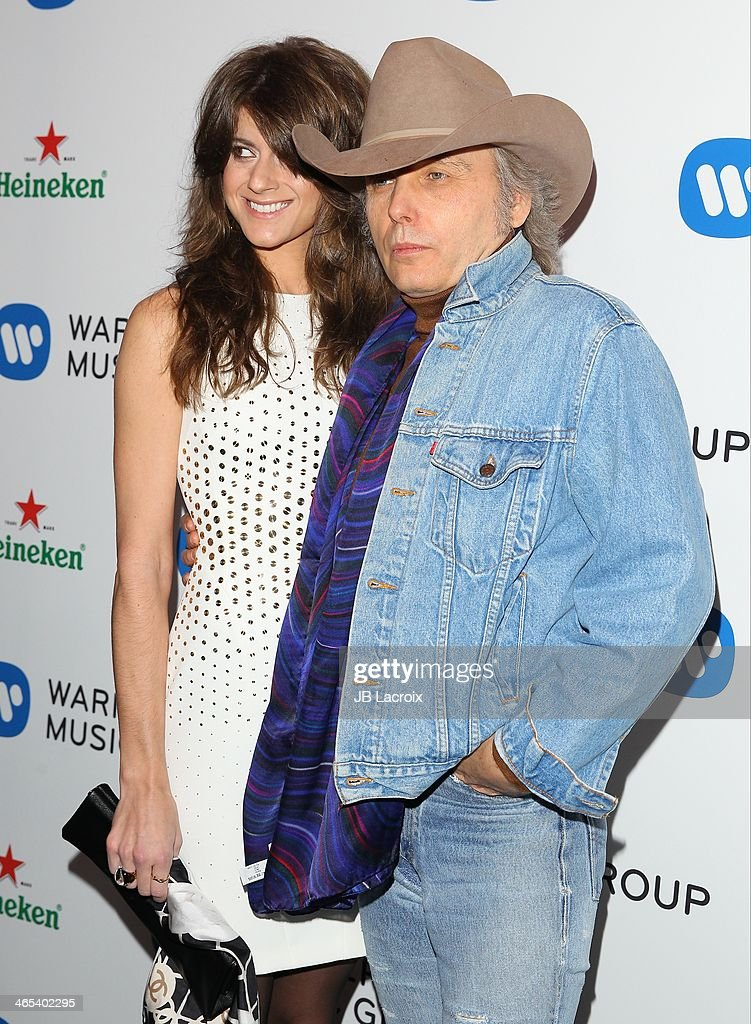 Emily Joyce and <a gi-track='captionPersonalityLinkClicked' href=/galleries/search?phrase=Dwight+Yoakam&family=editorial&specificpeople=211566 ng-click='$event.stopPropagation()'>Dwight Yoakam</a> attend the Warner Music Group Hosts Annual Grammy Celebration held at Sunset Tower on January 26, 2014 in West Hollywood, California.