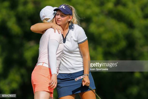 Emily K Pedersen of Denmark hugs Morgan Pressel on the 18th green at the conclusion of her round during the first round of the LPGA Marathon Classic...