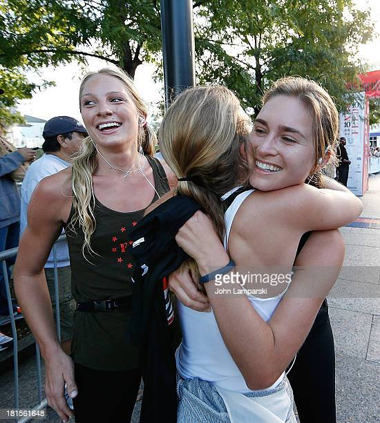 Emily Kenison Ashley Bush and Lauren Bush attend RUN10 FEED10 In New York City at Pier 84 on September 22 2013 in New York City