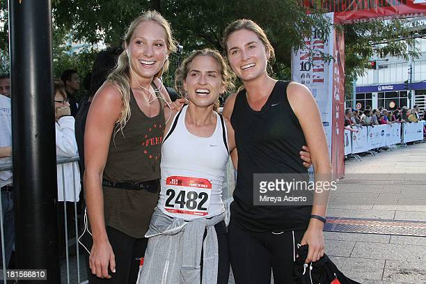 Emily Kenison Ashley Bush and Lauren Bush attend the 2nd annual RUN10 FEED10 at Pier 84 on September 22 2013 in New York City