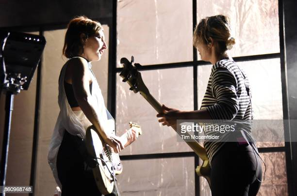 Emily Kokal and Jenny Lee Lindberg of Warpaint perform during the 'Global Spirit Tour' at ORACLE Arena on October 10 2017 in Oakland California