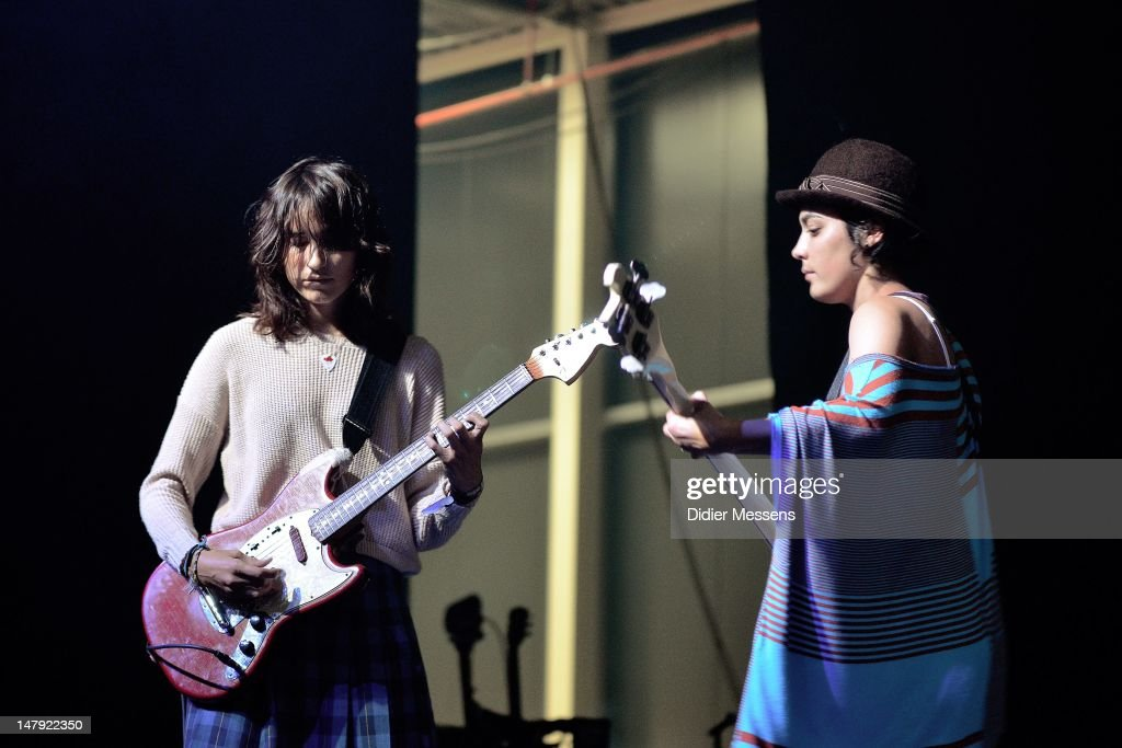 Emily Kokal and Jenny Lee Lindberg of Warpaint performs on stage during Les Ardentes Festival on July 5 2012 in Liege Belgium